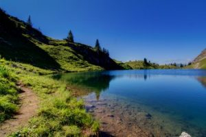 thumb bigstock Alpine Lake In The Mountains 50735213